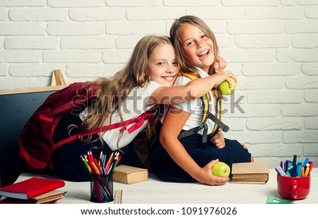 Back to school and home schooling. little girls back to school at knowledge day #1091976026