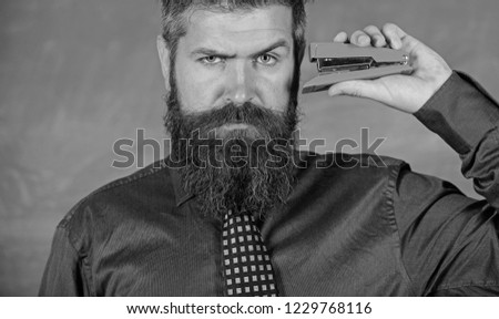 Back to school and studying. Teaching memorization techniques. Teacher bearded man with pink stapler chalkboard background. Pin it on mind. Hipster teacher formal wear with neck tie holds stapler.