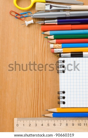 back to school and supplies on wood background