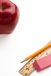 Back to school. Apple,pencil,ruler and eraser on white background with copy space.