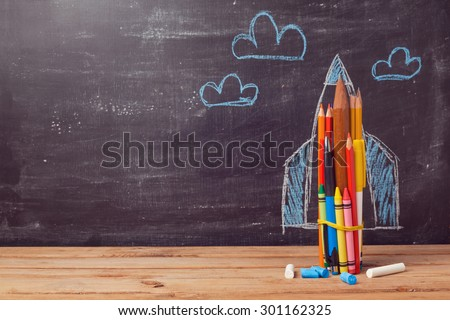 Back to school background with rocket made from pencils