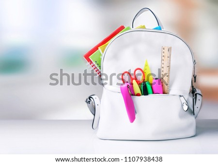Back to school.Backpack with school supplies empty space background.
