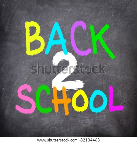 Back to School Blackboard / Chalkboard. Colorful chalk board writing Back to School in many colors.