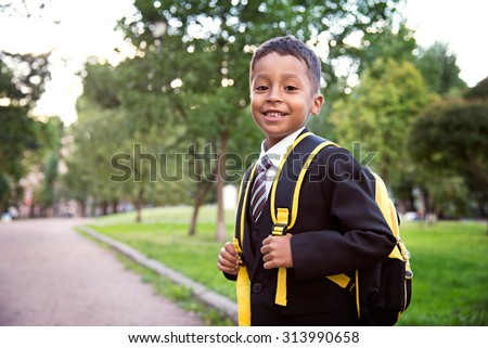 Back to school. Boy from elementary school at the school yard.
