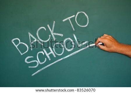 Back to school chalkboard. Green chalk blackboard written Back To School with white chalk.