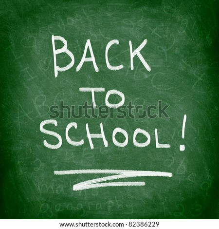 Back to school chalkboard. Green chalk blackboard written Back To School with white chalk. Nice texture. - stock photo