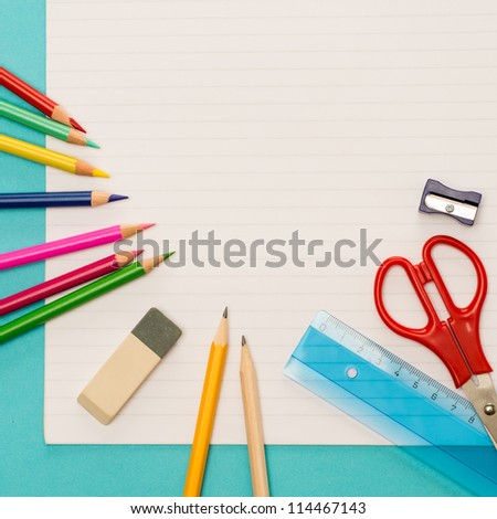 Back to school children accessories on striped notepad