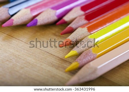 Back to School concept. A lot of colorful pencils are in a row over a wooden table. #363431996