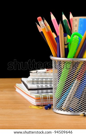 back to school concept and office supplies isolated on black background