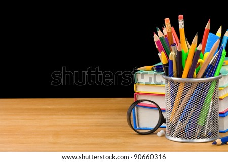 back to school concept and pile of books isolated on black background