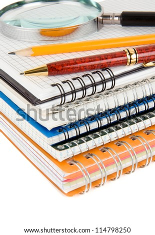 back to school concept and pile of notebooks isolated on white background