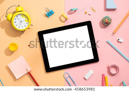 Back to school concept. Blank tablet with school and office supplies on office table. Top view with copy space.
