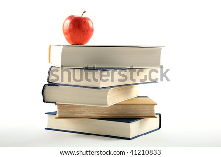 back to school concept, books with an apple, isolated on white