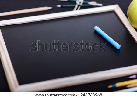 Back to school concept, colored pencils on black table, multicolored stationery accessories for educator teaching kid drawing on empty wooden desk, creative education background, top view, copy space #1246763968