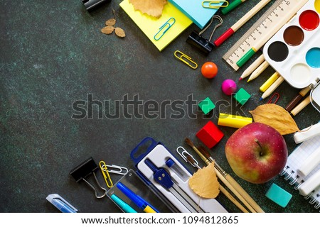 Back to school concept. Items for the school on blackboard dark table. Top view flat lay background, copy space.  #1094812865