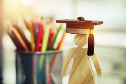 Back to School Concept, People Sign wood with Graduation celebrating cap blur pencil box, show alternative studying. Graduate or Education knowledge learning study abroad international Ideas.