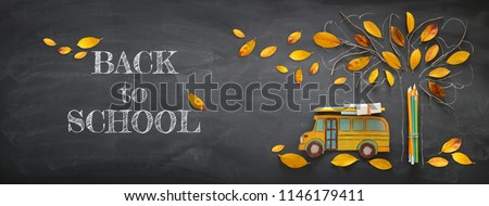 Back to school concept. Top view banner of school bus and pencils next to tree sketch with autumn dry leaves over classroom blackboard background #1146179411