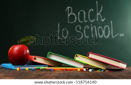 Back to school concept with apple, books and accessories