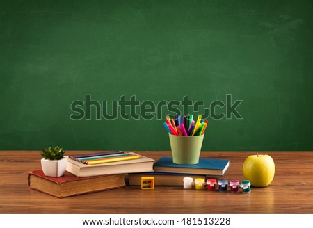 Back to school concept with clear blackboard background, desk, items