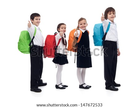 Back to school concept with happy kids giving thumbs up sign - isolated