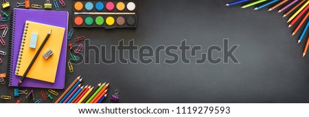 Back to School Concept with Stationery Supplies and Blackboard #1119279593