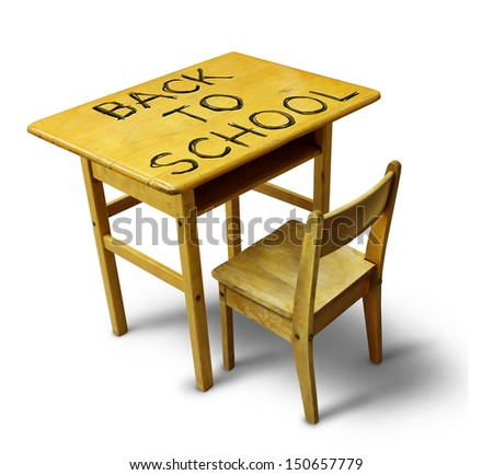 Back to school desk with a wooden education furniture equipment with the text scratched into the wood as a symbol of students returning to learning at a public institution
