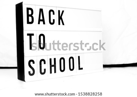 Back to School displayed on a vintage retro Lightbox. Concept image