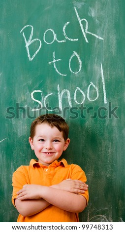 Back to school education concept with child in front of chalkboard
