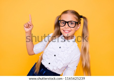 Back to school! First grade junior lifestyle teen concept. Close up studio photo portrait of cute girl gesturing up wearing trendy blouse white outfit isolated bright shine background #1165625239