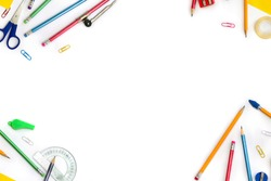 Back to School. Frame of school supplies ( pencil, scissors, sharpener, clips, crayons ) on a white background with space for text. Top view, flat lay