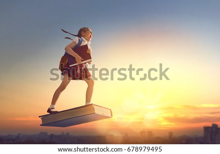 Back to school! Happy cute industrious child flying on the book on background of sunset urban landscape. Concept of education and reading. The development of the imagination. #678979495