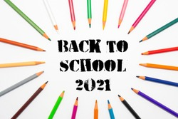 Back to school 2021, pencils. White background. Text Back to school 2021. Horizontal photography.