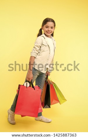 Back to school sales and deals. Back to school season great time to teach budgeting basics children. Girl carries shopping bags. Prepare for school season buy supplies stationery clothes in advance.
