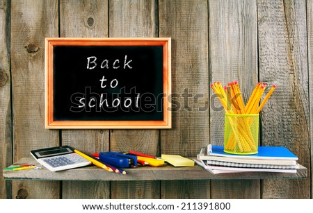 Back to school. School accessories on a wooden background. #211391800