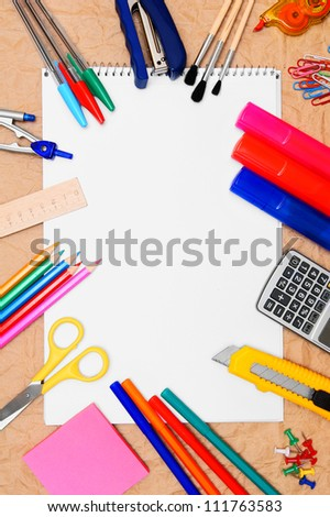 Back to school. School tools and a notebook. - stock photo