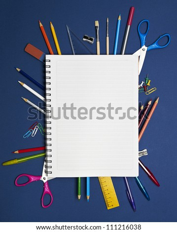 Back to School Series: school supplies on blue background