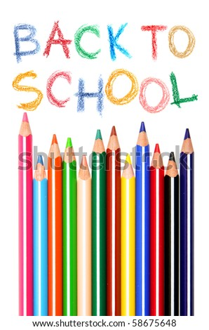 Back to school text and crayons over white background - stock photo