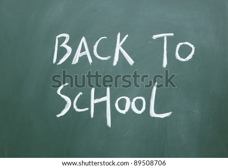 back to school title drawn with chalk on the blackboard