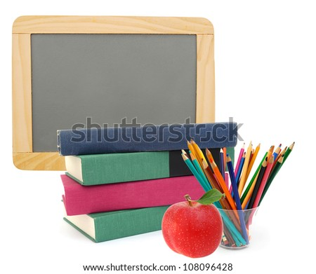 Back to school with books, pencils and chalkboard