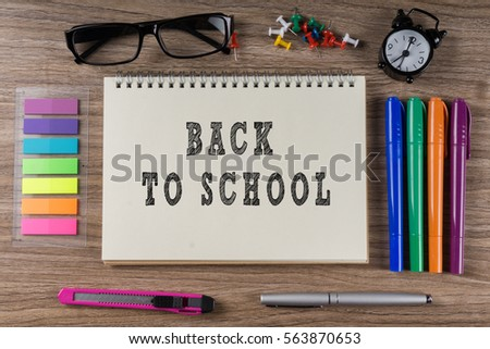 BACK TO SCHOOL word on notebook.