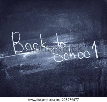 back to school written on blue chalkboard school theme vintage