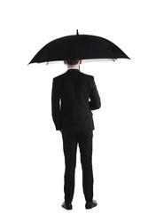 Back view business man standing holding umbrella isolated over white background