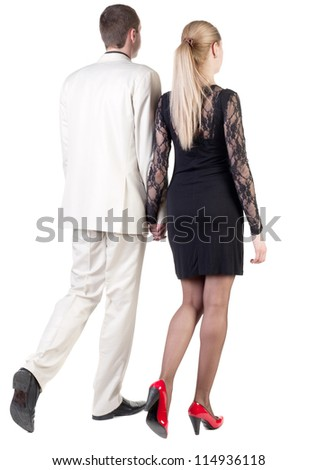 Back view going young business couple (man and woman). walking beautiful friendly girl in dress and guy in suit. Rear view people collection. backside view of person. Isolated over white background.