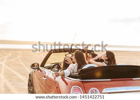 Back view image of a gorgeous pretty young pretty group of women friends driving the car. #1451422751