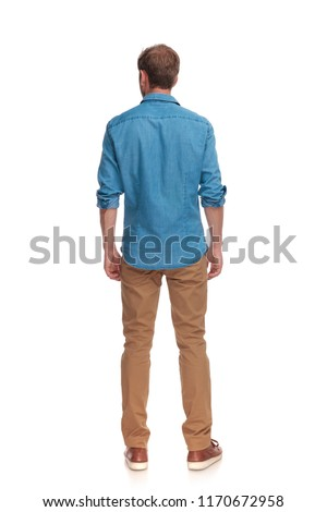 back view of a casual man standing on white background