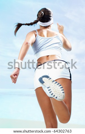 Back view of a girl running against blue background - stock photo