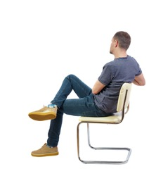 Back view of a man sitting on a chair. Rear view people collection.  backside view of person.  Isolated over white background. The student listens to the lecture comfortably sitting on a chair