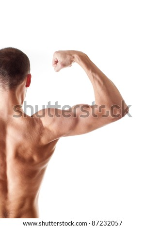 back view of a muscular young man showing his biceps isolated on white