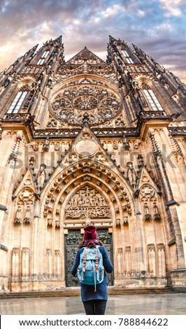 Back view of a stylish tourist backpacker woman admires of a beautiful architectural building during walking in European city #788844622