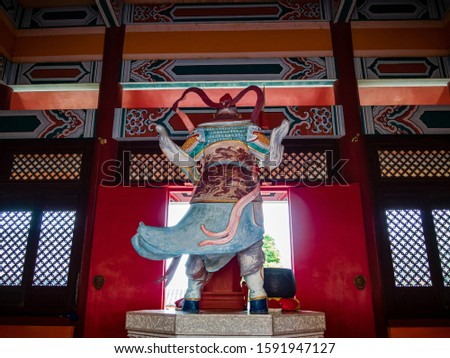 Back view of a Taoist diety, General Tian Peng, at a Taoist temple in Wen Bi Feng, Hainan, China.